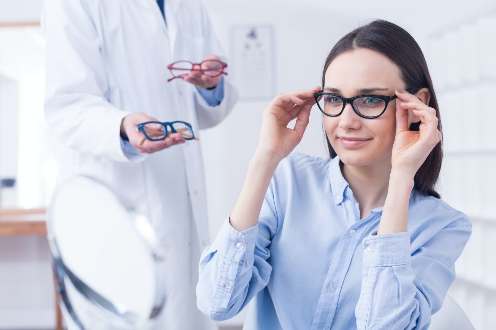 Optician with eyeglasses and client