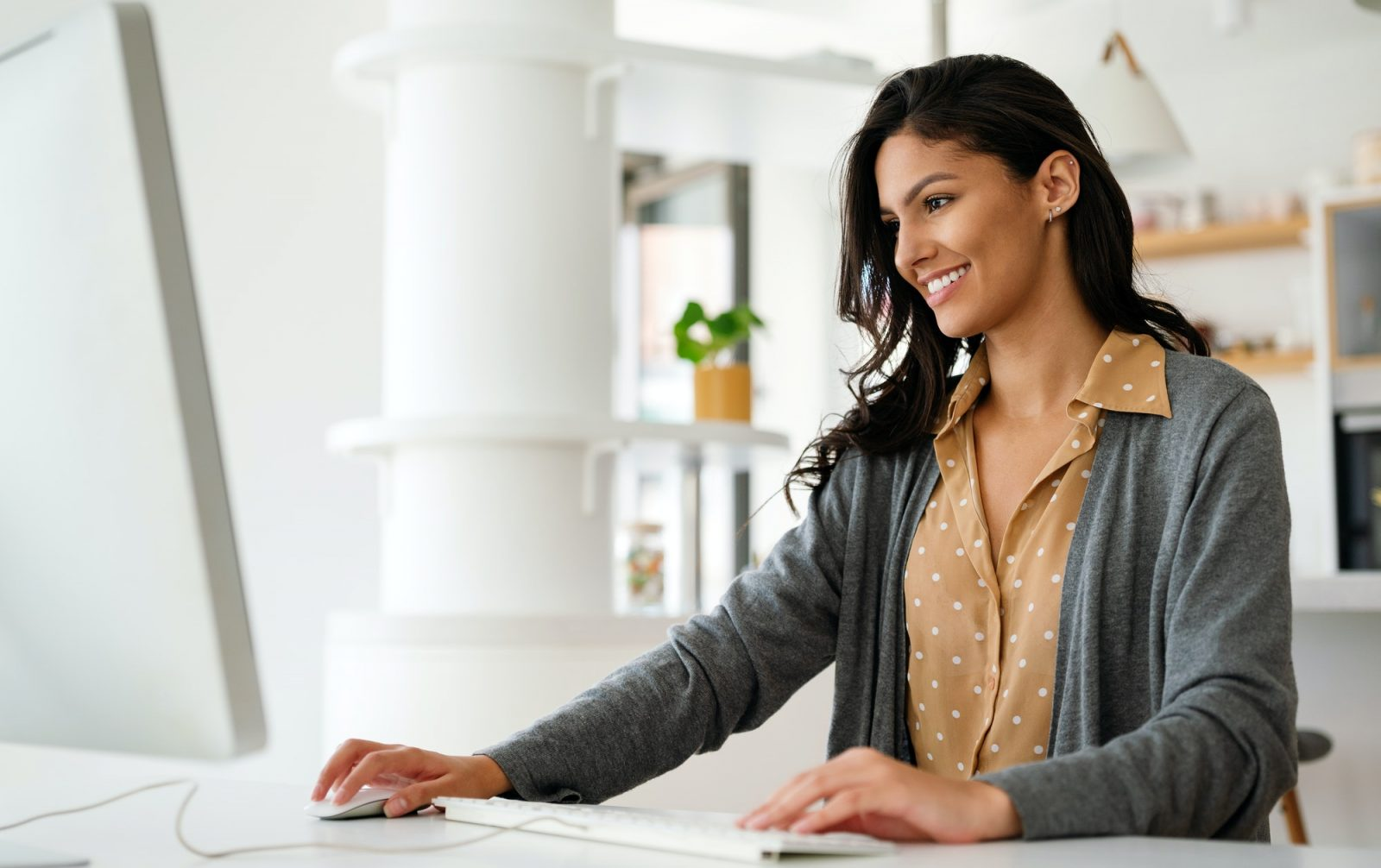 Beautiful student woman learning online on computer at home. Technology, education concept